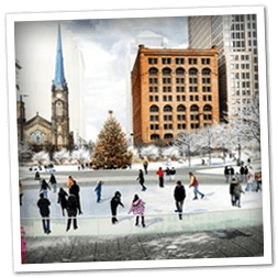 Ice skating at Cleveland's Public Square during Christmas nearby Mr. Kringle's Inventionasium Experience.