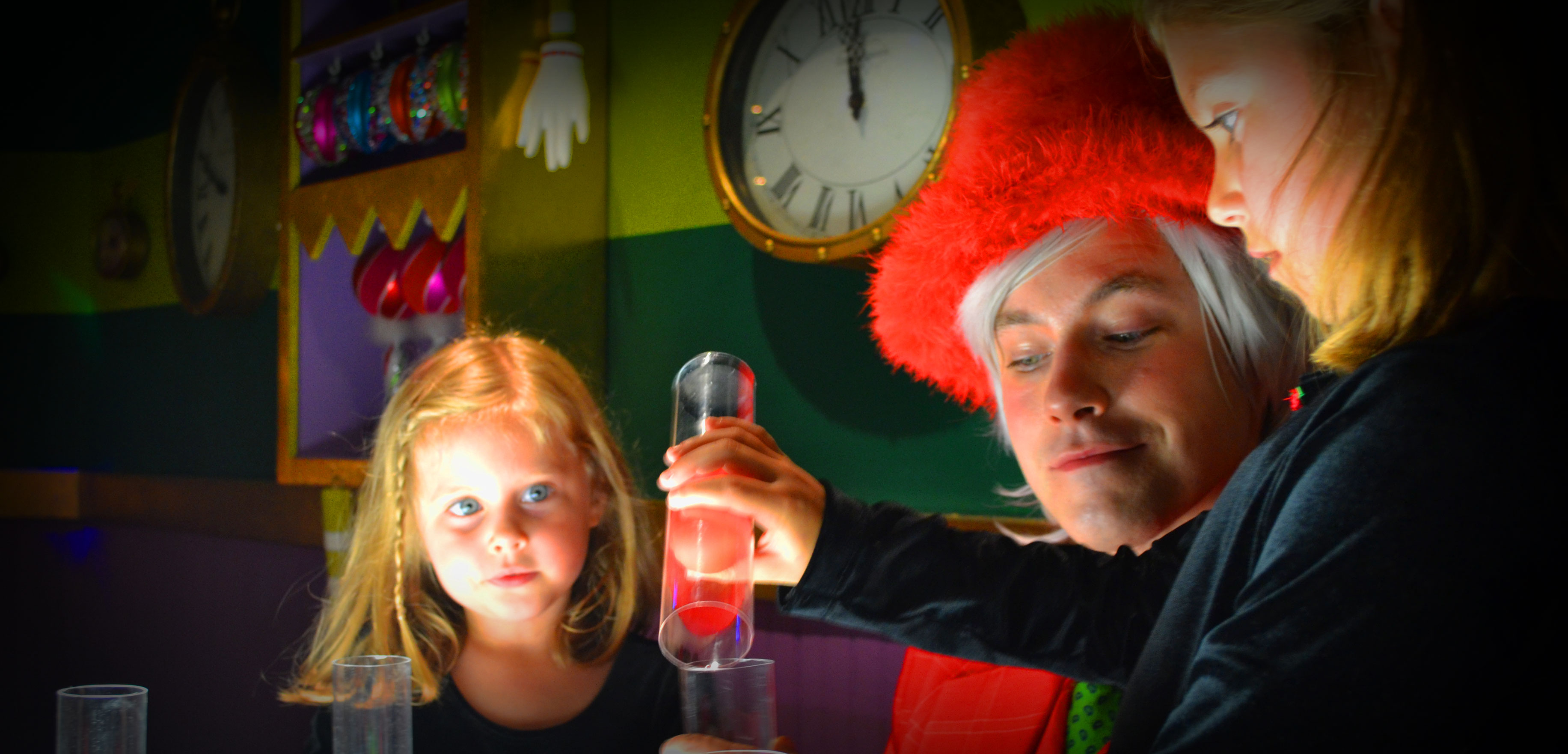 Kids experimenting with a Christmas elf at Mr. Kringle's Inventionasium Experience in Cleveland, Ohio