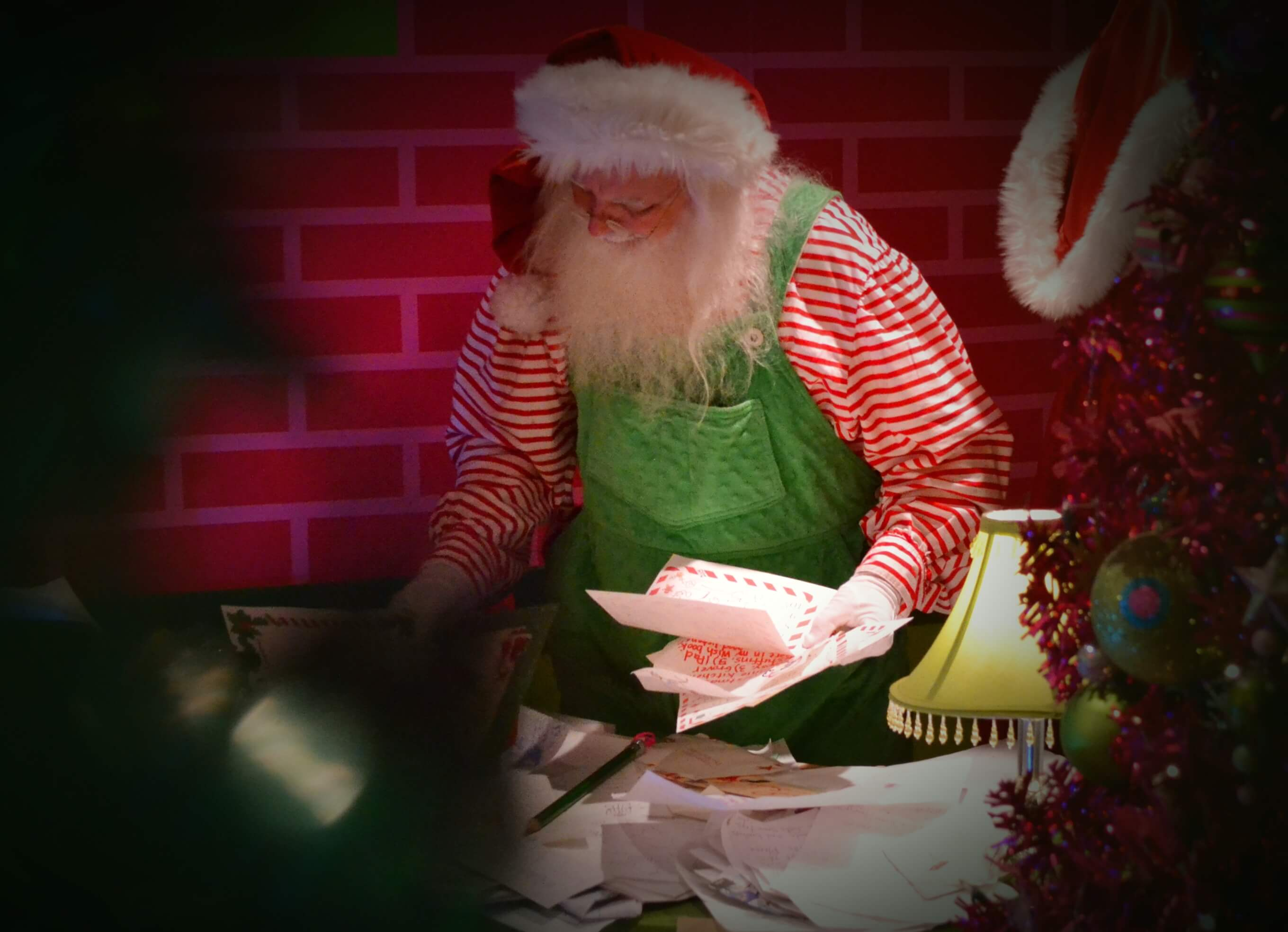 A Christmas elf opens magical doors at Mr. Kringle's Inventionasium Experience in Cleveland, Ohio's Tower City mall